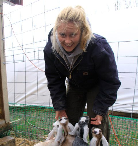 Sara Stockwood feeding goats